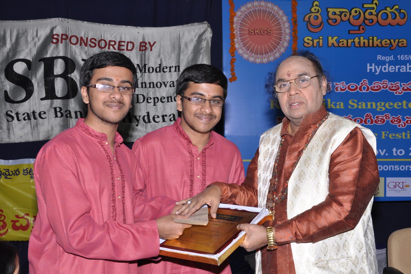 Yuva Pratibha Puraskaram 2014 awarded to Sri Ambale Heramba & Sri Ambale Hemantha . Award given by Mridangam Maestro Dr. Yella Venkateswara Rao